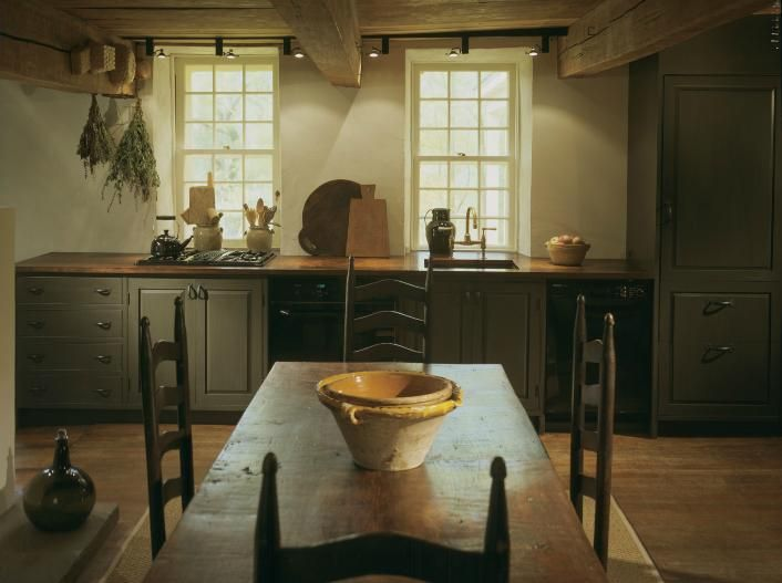 FARMHOUSE INTERIOR Vintage Early American Farmhouse Showcases Raised Panel Walls Barn Wood Floor Exposed Beamed Ceiling And A Simple Style For