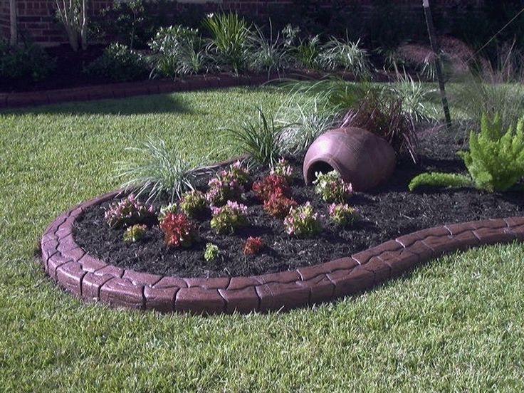 View photos of landscaping, stamped concrete borders, landscape curbing,  and landscape lighting.