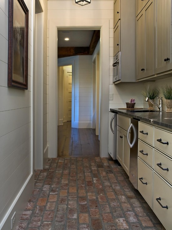 """example of hardwood to brick flooring.  might be cool to """"frame"""" the brick in hardwood along the perimeter of the kitchen to create a flow..."""