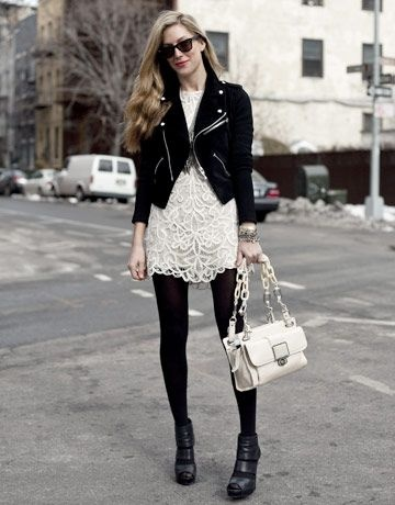 White lace dress; black leather jacket; black tights and booties
