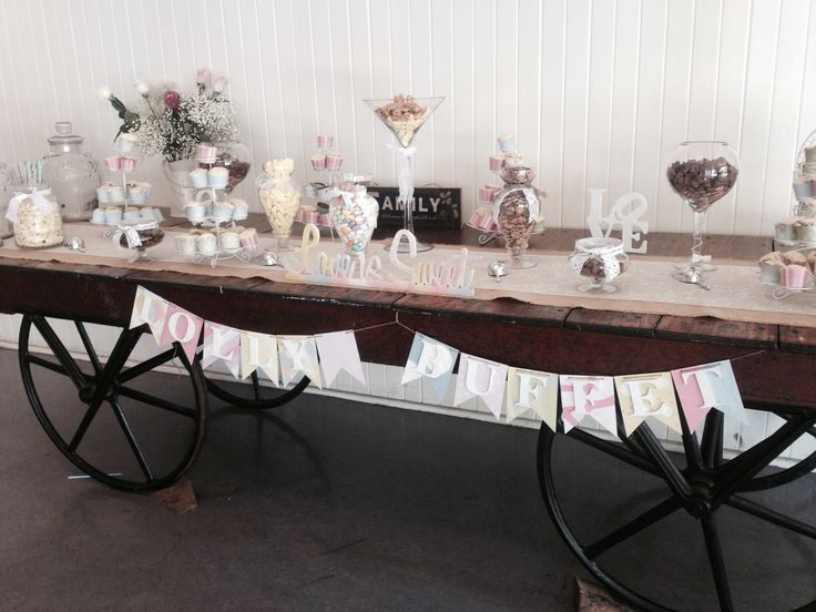 Wagon Wheel Candy Buffet #rustic #candybar #events