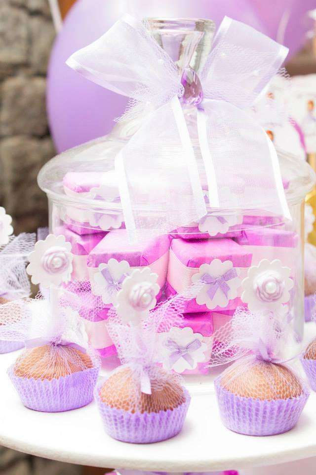 Pretty packaged cupcakes at a Sofia the First birthday party! See more party planning ideas at CatchMyParty.com!