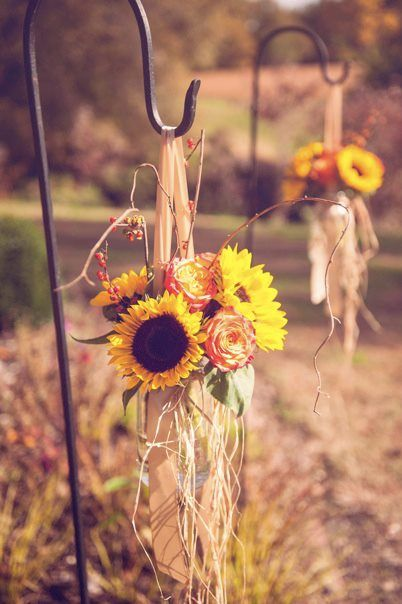 September wedding decorations- Love the shepherd's hooks to hang harvest themed decorations for a Fall wedding. Sunflowers, raffia, fall colours #sunflowers #wedding