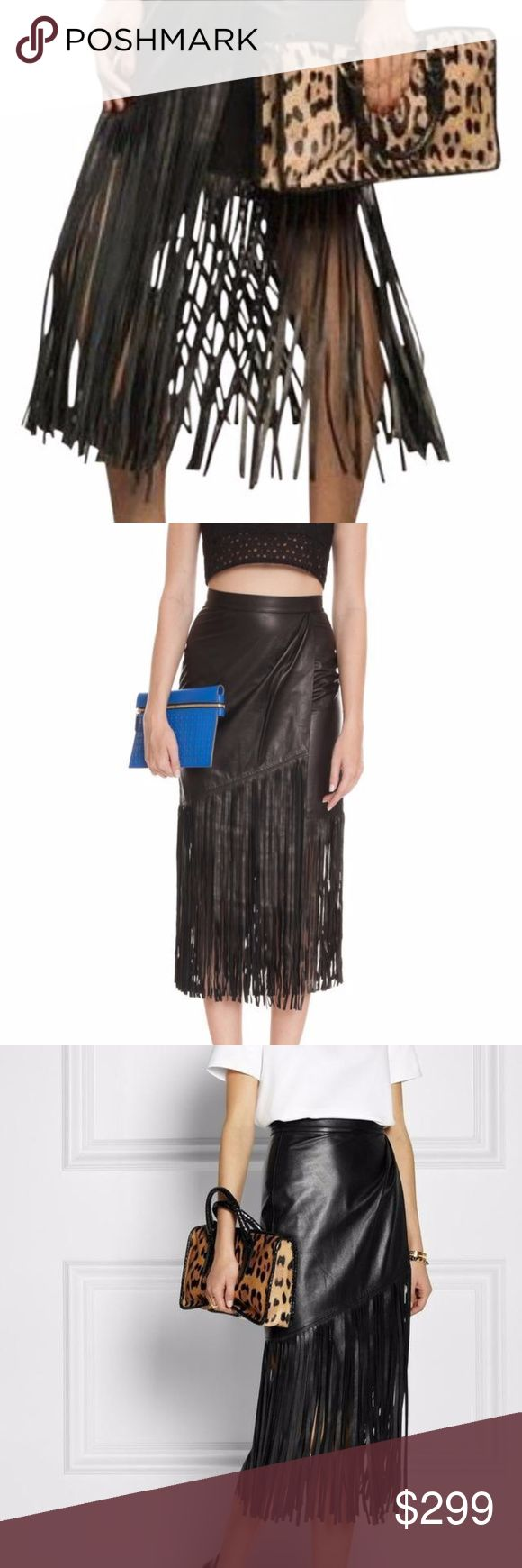 "New! Tamara Mellon Fringe Leather Skirt New Tamara Mellon Black Fringe Leather Skirt. Retail $895.00. Size: 10. Color: Black. A butter-soft leather skirt is a luxe option for day or night. The fringed hem lends this flattering wrap-effect style fluid movement. Keep it in focus with a basic white top and simple sandals. Black leather. Wrap-effect front, fringed hem, fully lined. Concealed hook and zip fastening at back. 29"" waist, 40"" hip, 20"" length without the fringes.  100% leather (Lamb)…"