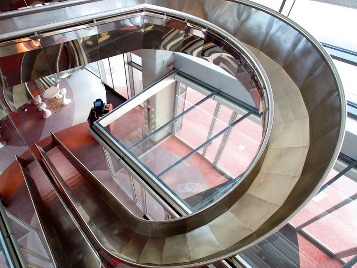 Barcelo Hotel in Malaga, Spain. The rooms look cool and you can get downstairs via a slide!