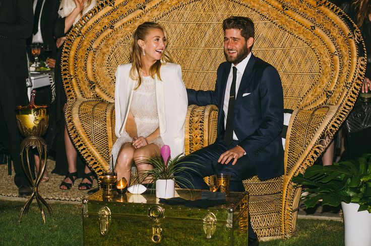 For the reception, Whitney switched into a fringed minidress and added a chic white cape.