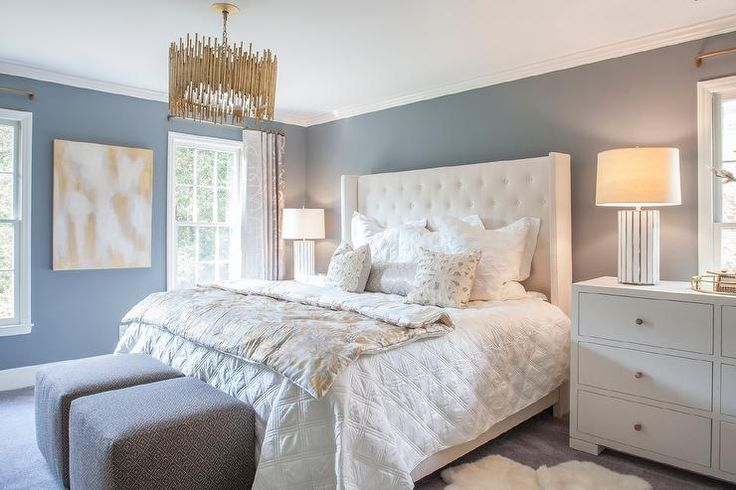 Restful White And Blue Bedroom Boasts Slate Blue Walls Framing A White Tufted Wingback Bed