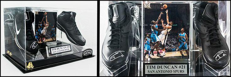 Signed Tim Duncan shoes is display case. www.vogtauction.com