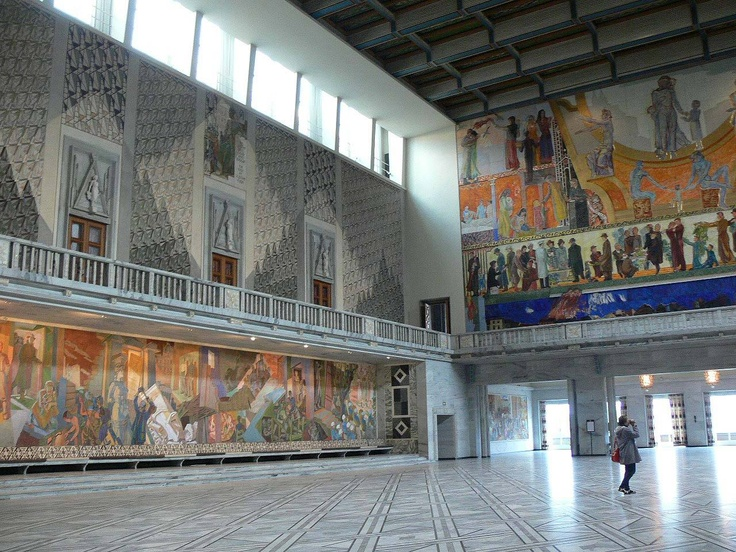 The grand Central Hall at Oslo City Hall decorated with murals by artist Henrik Sørensens.