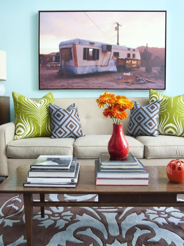 light color wall, bright pieces.cushions beige green and gold