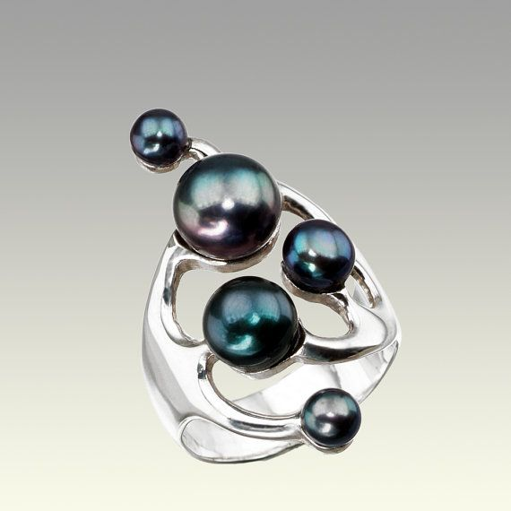 Ring with unconventional design in sterling silver and five black pearls on Etsy, $126.00