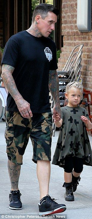 Birthday girl: Pink, right, celebrated her 36th birthday with her husband Carey Hart and daughter Willow (both left) in New York City on Tuesday