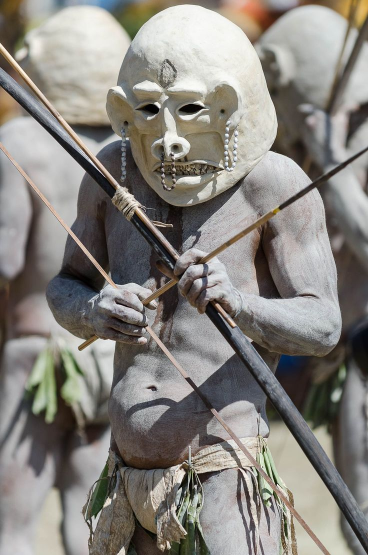 When the Asaro tribe was chased out of their village by a neighbouring tribe, they hid in a nearby river. When they got back to the river bank at dawn, they where covered in mud. This scared their enemies, who thought they were the ghosts of the Asaro. Since that day, they wear mud as their hunting outfit.