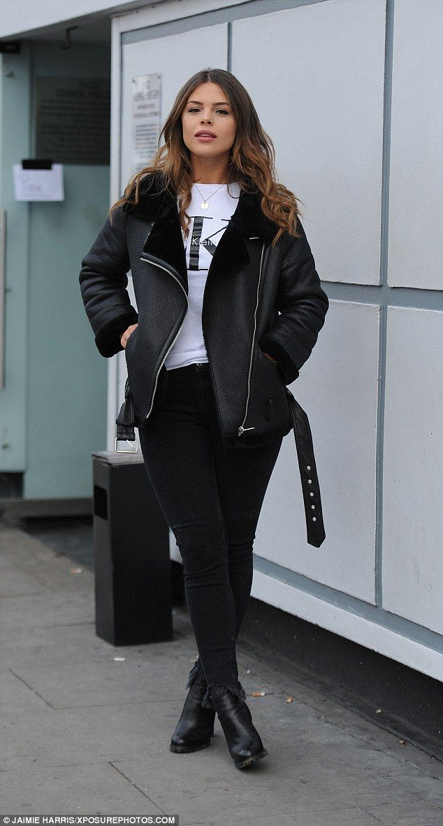 Hell for leather! Chloe Lewis also opted to shy away from green, donning skinny black jeans with a white Calvin Klein T-shirt with her fur-lined leather jacket