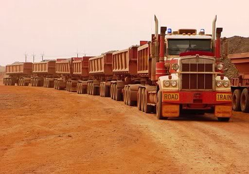 Now these road trains ONLY travel on purpose built haul roads in the Pilbara North of Australia, carting iron ore from various mine sites to drop off points to be loaded onto trains which then gets taken to the nearest ports which then get loaded onto ships.