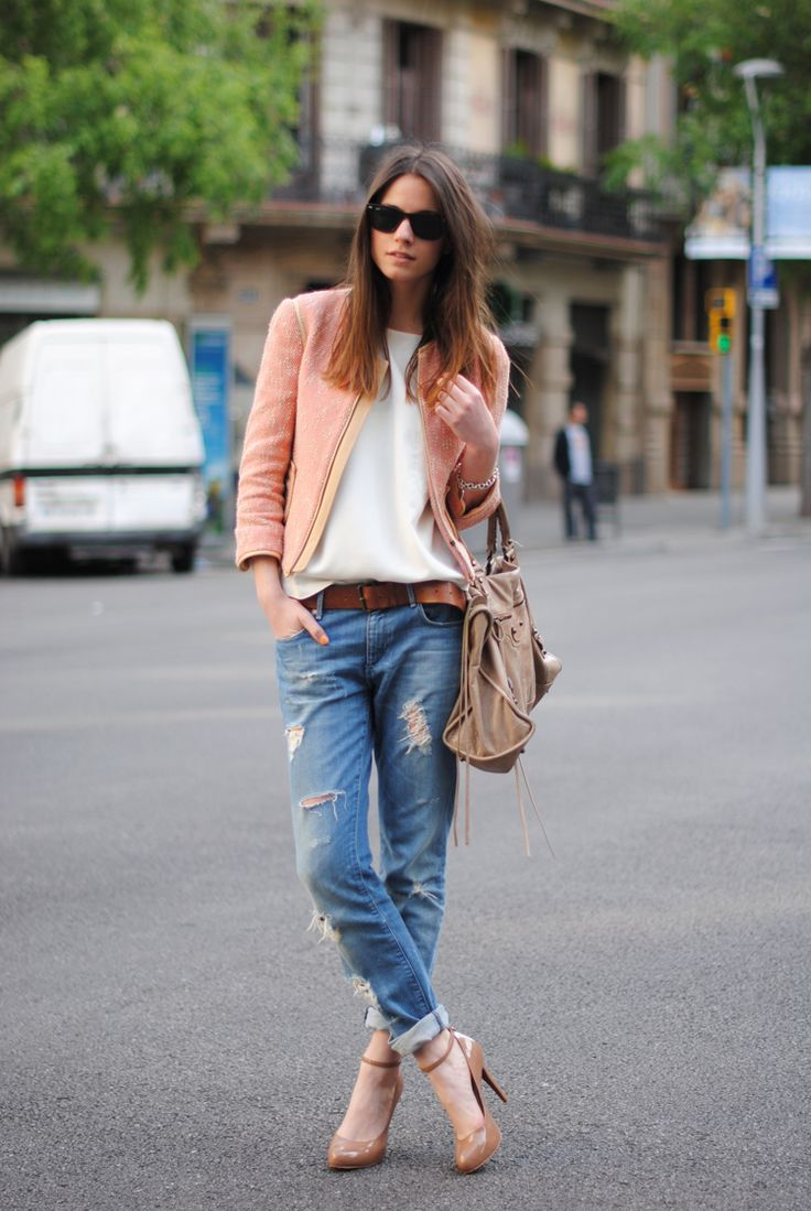 destroyed boyfriend jeans gussied up with a peach boucle tweed jacket and nude patent ankle strap pumps.