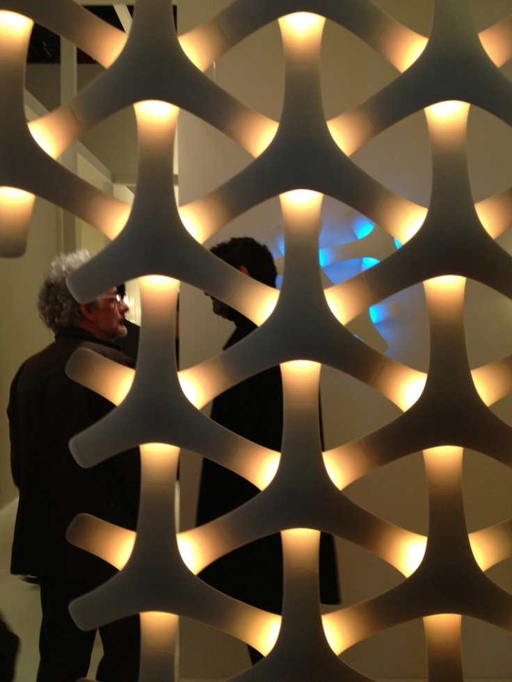 It's hard to look away from this intriguing back-lit screen laced with peepholes. Synapse modular lighting system by Francisco Gomez Paz for Luceplan.