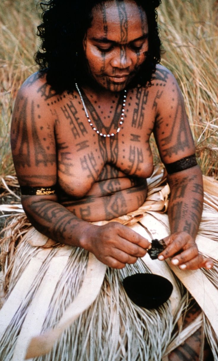 Papua New Guinea | Preparing the tattoo ink (charcoal and coconut oil). 1958 || ©Percy Cochrane