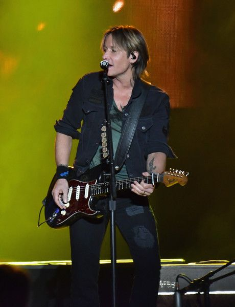 Keith Urban Photos Photos - Country musician Keith Urban performs at the AT&T Block Party during the NCAA March Madness Festival at Margaret T. Hance Park on March 31, 2017 in Phoenix, Arizona. - NCAA March Madness Festival 2017 - Day 1