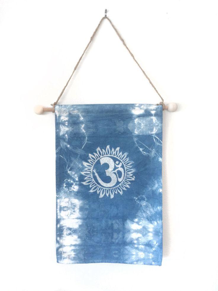 shibori wall hanging, indigo, wall tapestry, om sign, yoga decor, home decor, boho chic, bohemian home decorations, wall art by WyomingCreativeEast on Etsy https://www.etsy.com/listing/285815037/shibori-wall-hanging-indigo-wall