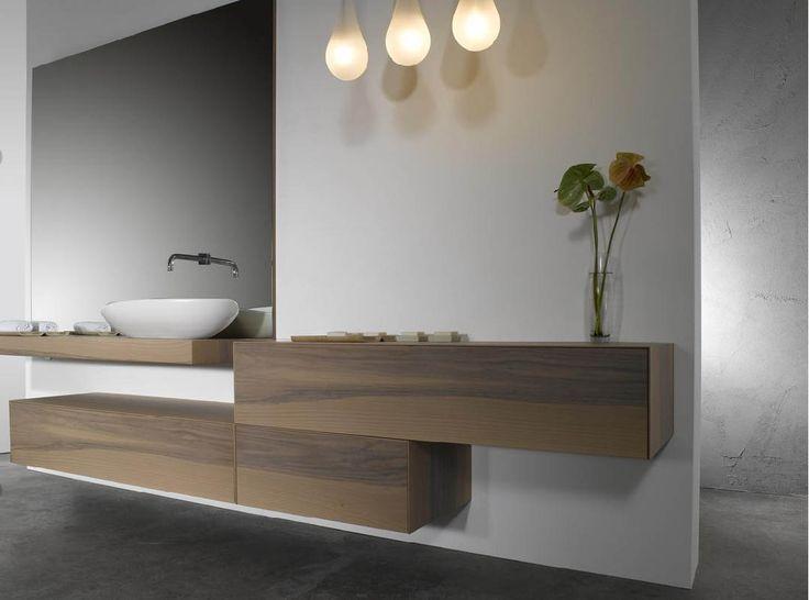 bathroom basin on wood floating shelf, plus separate single storage underneath. Clean lines, air, space, contemporary