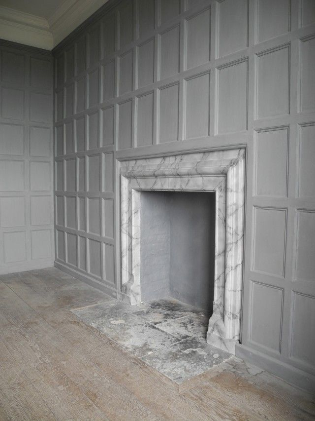 beautiful millwork and antique fireplace surround
