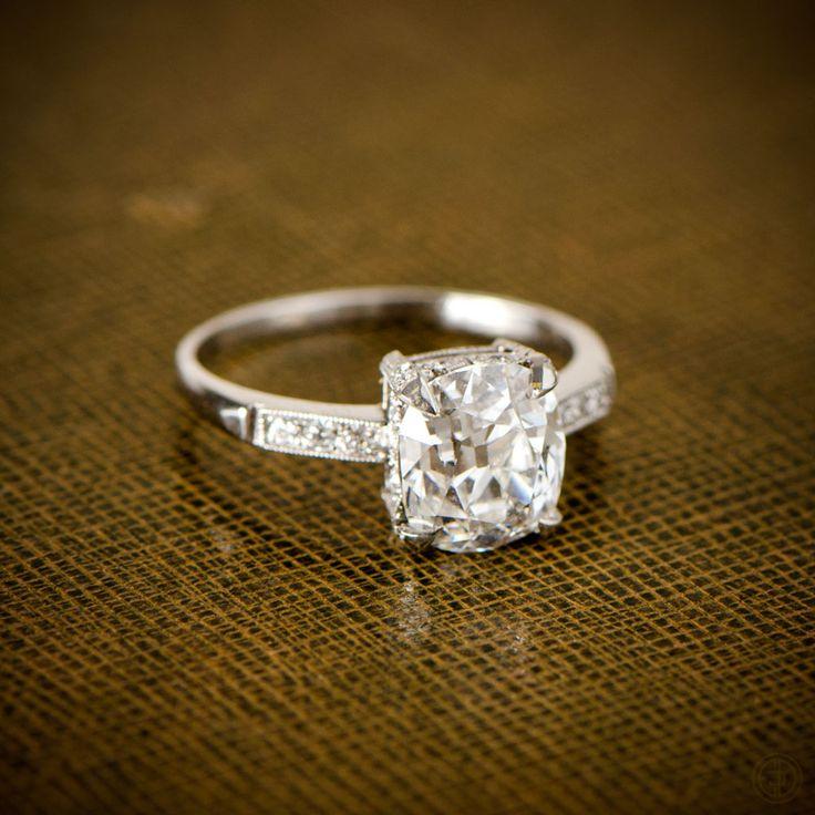 A beautiful antique cushion cut diamond engagement ring, set in a stunning handmade platinum mounting.