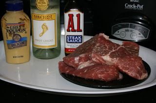 A-1 and Dijon Steak CrockPot Recipe - also added garlic and dash of worchester.  Instead of white wine used 1/4 cup chicken broth, 1/2 Tbsp red wine vinegar & 1/2 Tbsp AJ