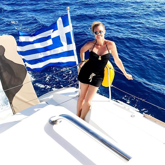 """""""Celebrating 50 years of being Greek! (Ok... I may only be 25% Greek but here In Santorini I am 100%!) Thank you Caldera Yachting for a great cruise!) #Efharisto #disruptaging #agepositive #carpediem #therebellion #lovegreece"""" by @aging.gracefully."""