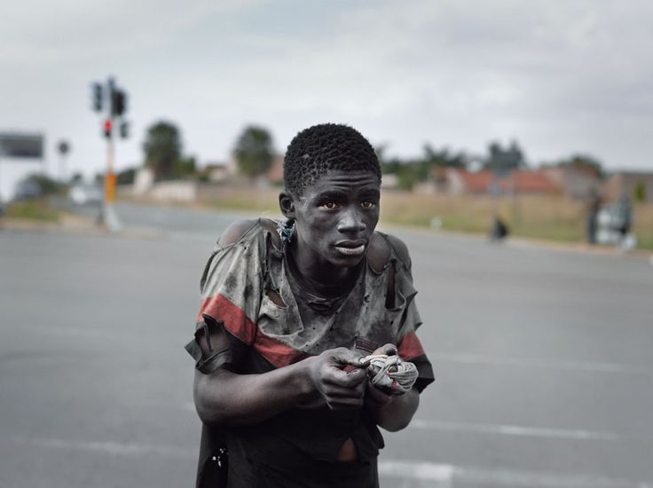 """Exhibition: 'Pieter Hugo: Kin' at Fondation Henri Cartier-Bresson, Paris. """"Hugo is one of the brightest of stars in the photographic firmament."""" http://artblart.com/2015/03/05/exhibition-pieter-hugo-kin-at-fondation-henri-cartier-bresson-paris/ Photo: Pieter Hugo. 'At a Traffic Intersection, Johannesburg' 2011"""