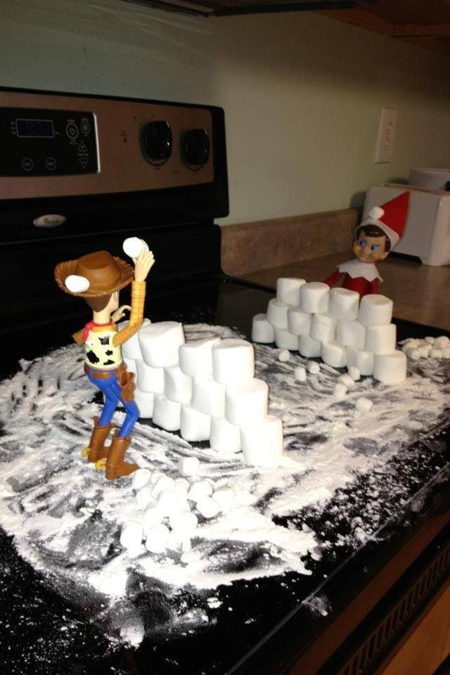 elf on a shelf snowball fight! Wonder if Cas and Izzy would like an elf...........