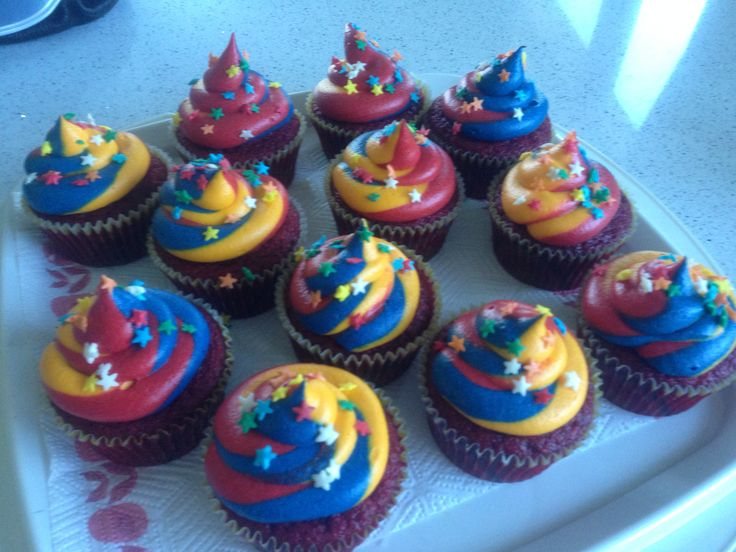 Red velvet cupcakes with carnival coloured buttercream