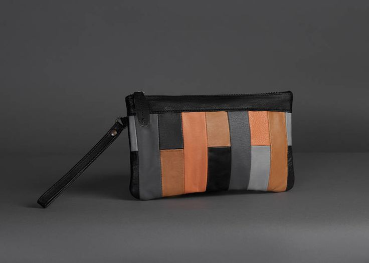 Classical and stylish clutch bag in stunning rich coloursThis stunning and stylish multi coloured clutch bag is made of the softest cow leather. With a fully lined inner, it has a zipped closure drawn with a leather tab. It can be carried by the attached wrist strap leaving you for 'hands free socialising'. Stunning rich colours will stand you apart from the crowd. Size: 24 x 19 cmCow leather with 100% cotton linerSize: 24 x 19 cm
