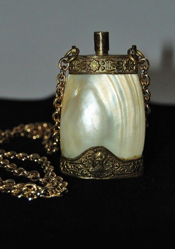 antique perfume bottle made of seashell-I have a similiar shell bottle.  Mine has the chain on top