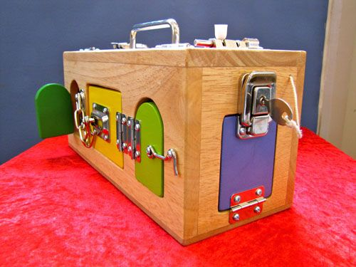 Lock box. When my kids were little they had one of these - awesome toy. Bet it would be pretty easy to make one.