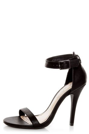 for the perfect little black heel! The Anne Michelle Enzo 01 Black Ankle Strap Sandal Heels keep it simple with a matte black toe strap in smooth vegan leather, paired with a sleek heel cup and ankle strap that adjusts with a silver buckle (and hidden elastic). Strut your stuff with a 4