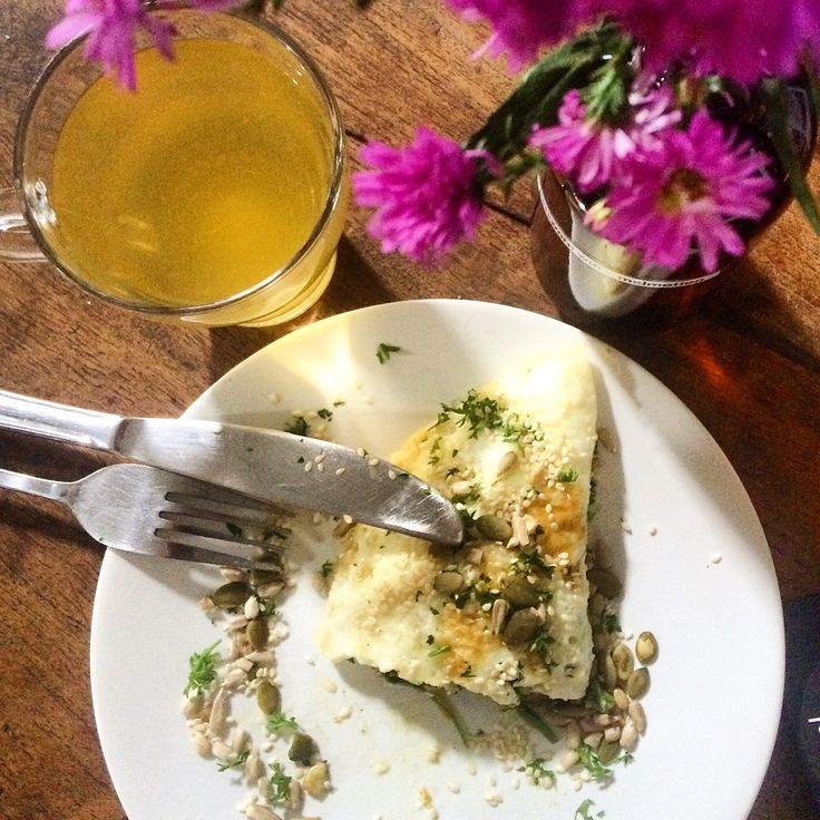 skinny protein breakfast: egg white omelette filled with spinach, seeds topping and grean tea by Avocado cafe Bali