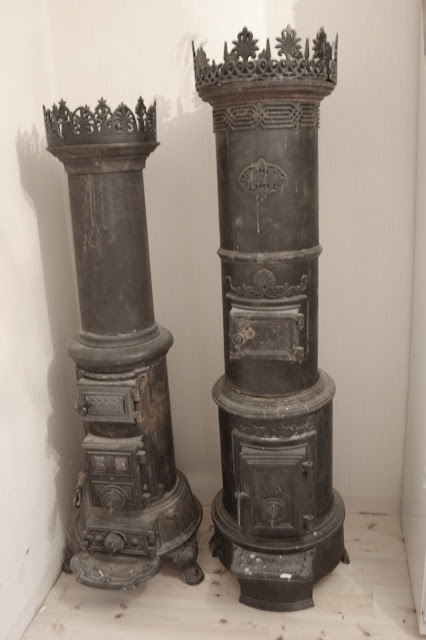Antique round ornamented iron heating stoves