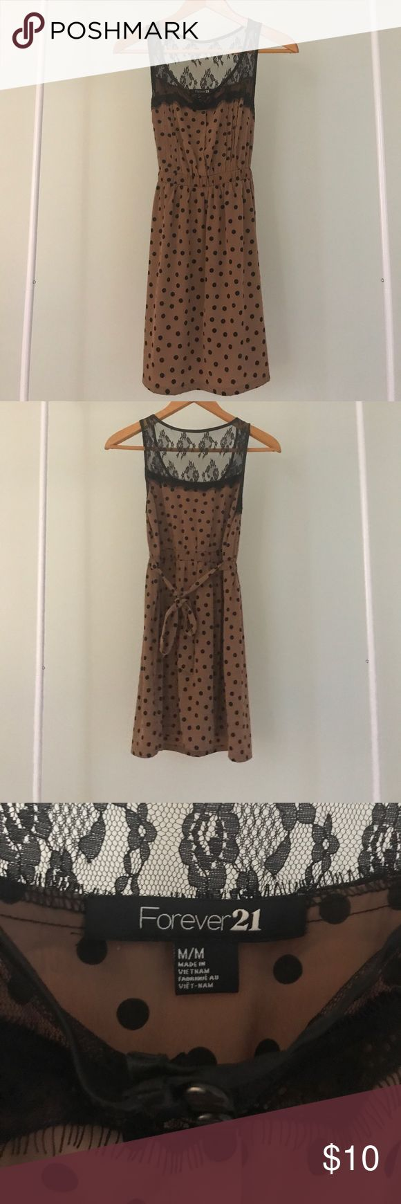 Women's fit and flare dress Women's Fit and Flare Dress. Size M. From Forever 21. Worn once. Tan with black polka dots and lace detail. Back of dress is tied for a more flattering fit. Forever 21 Dresses