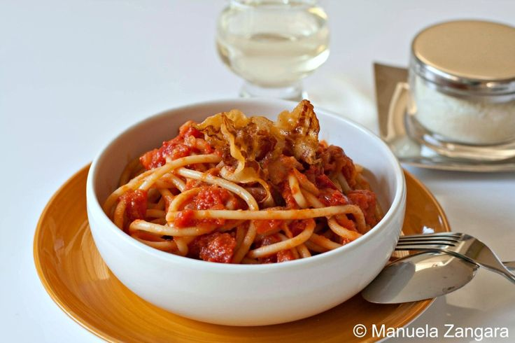 Bucatini all'amatriciana - a typical recipe from Rome: pasta with tomato sauce, guanciale and Pecorino Romano.
