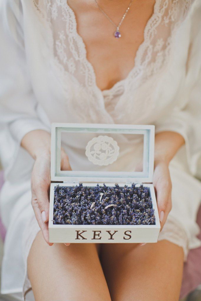 Creative way to display the wedding bands, in a box filled with lavender