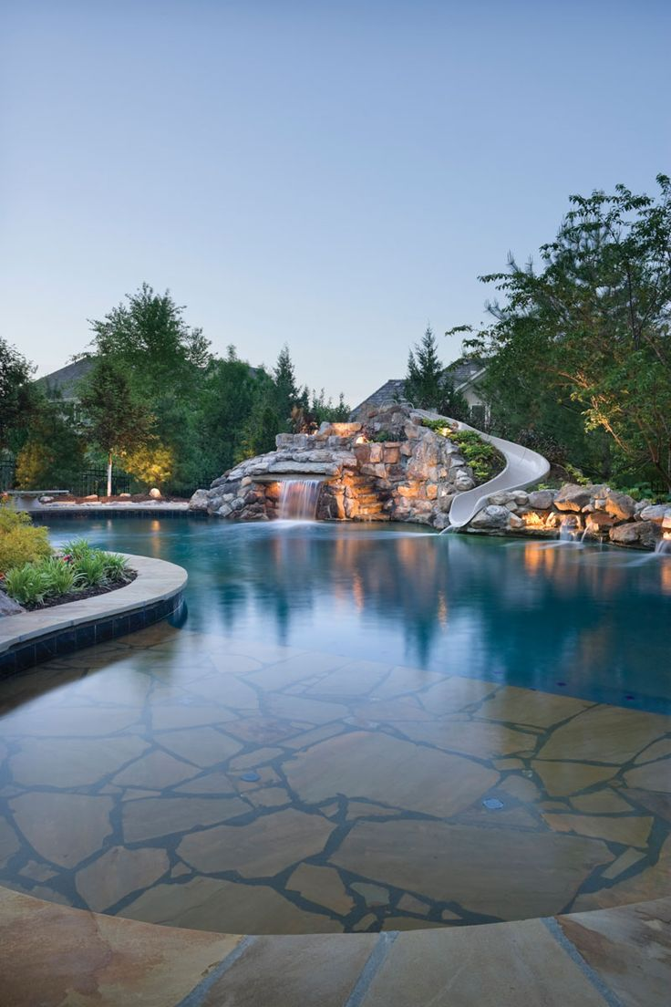 Magnificent in stature and beauty, the natural boulder waterfall definitely attracts attention. The structure also features a spacious grotto and a custom-crafted fiberglass waterslide that add to the fun and excitement. For those who need a moment's rest, a tanning shelf sits on the other side of the pool, providing the perfect view of the whole fabulous setting. Banks Pool Spa Design, Overland Park, Kansas
