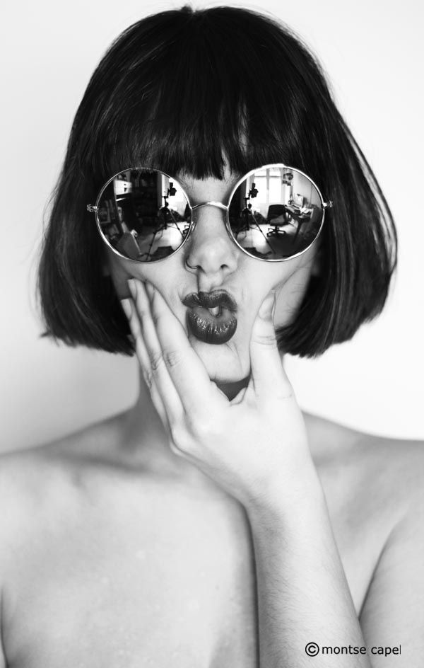 this is one of my favorite portraits i found on here. i love the reflective glasses and the composition. i dont even know why but its just fun and edgy