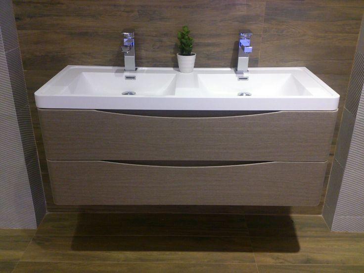Mueble de baño en melanina color nuez con gavetas mesón en quartzone blanco extra