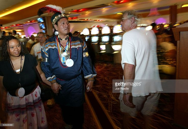 Seminole Herbert Jim and his wife April Jim walk through the casino May 11, 2004 during the grand opening for the Seminole Hard Rock Hotel and Casino in Hollywood, Florida. South Florida's Seminole Indian Tribe has opened the state's biggest casino complex. The hotel has 500 rooms, 4,000 video gaming machines, poker tables and several restaurants. The public area has large ballrooms and a six-acre pool site with a 180-foot water slide...