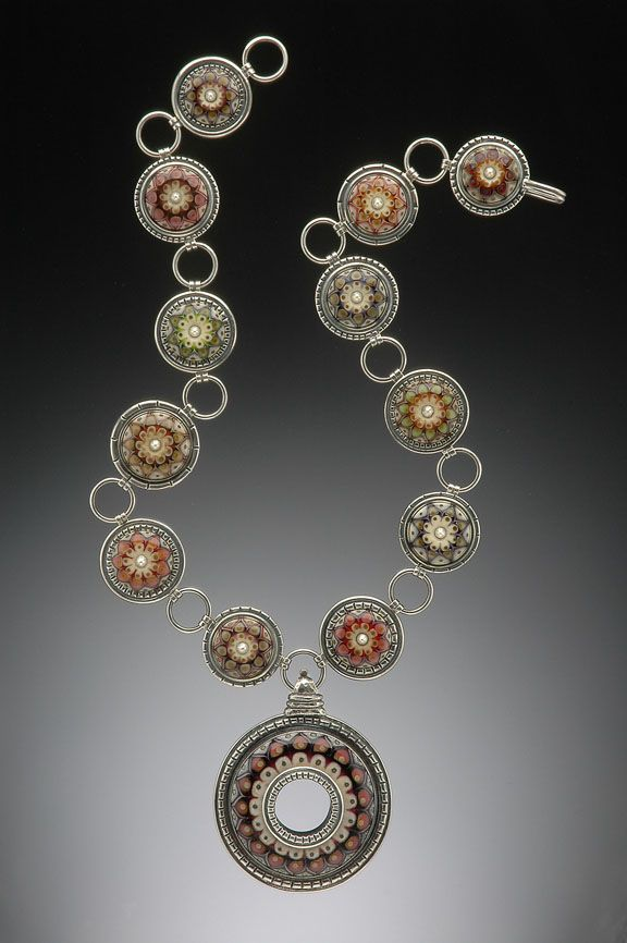 Kristina Logan...Lampworked glass beads set in sterling bezels...she is so amazing!