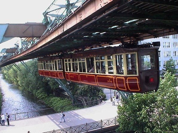 Wuppertal, Germany to ride the hanging trains. Oldest monorail system in the world, built in 1901.