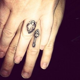 "Keep your love under lock and key. | 33 Impossibly Sweet Wedding Ring Tattoo Ideas You'll Want To Say ""I Do"" To"
