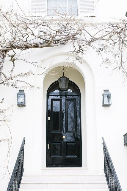 glossy black door on a white house