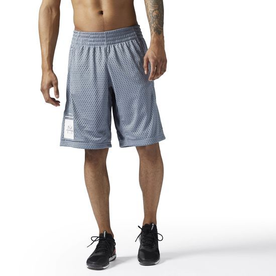 Reebok - LES MILLS Mesh Basketball Short: Step up your game in these LES MILLS mesh basketball shorts. All-over mesh allows for breathability, while the longer length provides added coverage that works perfectly for studio classes.